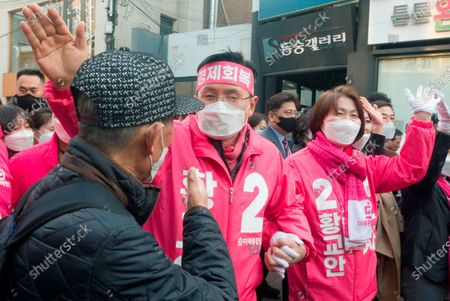 Hwang Kyo-ahn and Choi Ji-Young, Apr 11, 2020 : Wearing masks to prevent COVID-19 coronavirus infection, Hwang Kyo-ahn (C), chairman of South Korea's main opposition United Future Party (UFP) and his wife Choi Ji-Young (R) attend his election campaign for the April 15 parliamentary elections in his electoral district of Jongno Ward in Seoul, South Korea. Hwang's headband reads,'Economic Renewal'. Hwang is running for the election in Jongno, a symbolic constituency in Korean politics where influences in politics are elected. Lee Nak-yeon, former prime minister of South Korea and a candidate of the ruling Democratic Party is also running in the constituency for the general elections. Lee and Hwang have been ranked as the first and second as the next president of South Korea in recent polls. The quadrennial elections will fill the 300-seat unicameral National Assembly of South Korea.