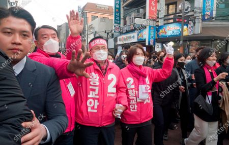 Hwang Kyo-ahn and Choi Ji-Young, Apr 11, 2020 : Wearing masks to prevent COVID-19 coronavirus infection, Hwang Kyo-ahn (3rd L), chairman of South Korea's main opposition United Future Party (UFP) and his wife Choi Ji-Young (4th L) attend his election campaign for the April 15 parliamentary elections in his electoral district of Jongno Ward in Seoul, South Korea. Hwang's headband reads,'Economic Renewal'. Hwang is running for the election in Jongno, a symbolic constituency in Korean politics where influences in politics are elected. Lee Nak-yeon, former prime minister of South Korea and a candidate of the ruling Democratic Party is also running in the constituency for the general elections. Lee and Hwang have been ranked as the first and second as the next president of South Korea in recent polls. The quadrennial elections will fill the 300-seat unicameral National Assembly of South Korea.