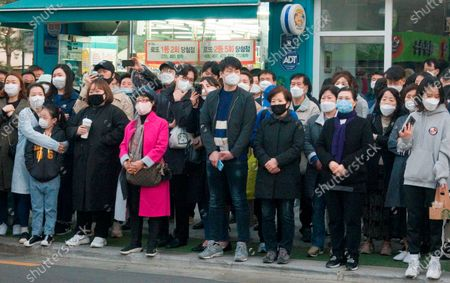 Supporters of Lee Nak-yeon, Apr 11, 2020 : Wearing masks to prevent COVID-19 coronavirus infection, supporters attend a campaign of Lee Nak-yeon, former prime minister of South Korea and a candidate of the ruling Democratic Party for the April 15 general elections, in Jongno district in Seoul, South Korea. Lee is running for the election in Jongno, a symbolic constituency in Korean politics where influences in politics are elected. Hwang Kyo-ahn, the head of the conservative right wing main opposition United Future Party (UFP), is also running in the constituency. Lee and Hwang have been ranked as the first and second as the next president of South Korea in recent polls. The quadrennial elections will fill the 300-seat unicameral National Assembly of South Korea.