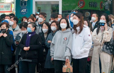Supporters of Lee Nak-yeon, Apr 11, 2020 : Wearing masks to prevent COVID-19 coronavirus infection, supporters attend a campaign of Lee Nak-yeon, former prime minister of South Korea and a candidate of the ruling Democratic Party for the April 15 general elections, in Jongno district in Seoul, South Korea. Lee is running for the election in Jongno, a symbolic constituency in Korean politics where influences in politics are elected. Hwang Kyo-ahn, the head of the conservative right wing main opposition United Future Party (UFP), is also running in the constituency. Lee and Hwang have been ranked as the first and second as the next president of South Korea in recent polls. The quadrennial elections will fill the 300-seat unicameral National Assembly of South Korea. Korean characters on a mobile phone (R) read,'Yony', which is short for Lee Nak-yeon.