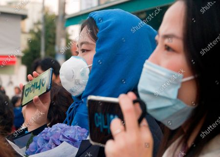 Supporters of Lee Nak-yeon, Apr 11, 2020 : Wearing masks to prevent COVID-19 coronavirus infection, supporters attend a campaign of Lee Nak-yeon, former prime minister of South Korea and a candidate of the ruling Democratic Party for the April 15 general elections, in Jongno district in Seoul, South Korea. Lee is running for the election in Jongno, a symbolic constituency in Korean politics where influences in politics are elected. Hwang Kyo-ahn, the head of the conservative right wing main opposition United Future Party (UFP), is also running in the constituency. Lee and Hwang have been ranked as the first and second as the next president of South Korea in recent polls. The quadrennial elections will fill the 300-seat unicameral National Assembly of South Korea. Korean characters on mobile phones read,'Yony', which is short for Lee Nak-yeon.