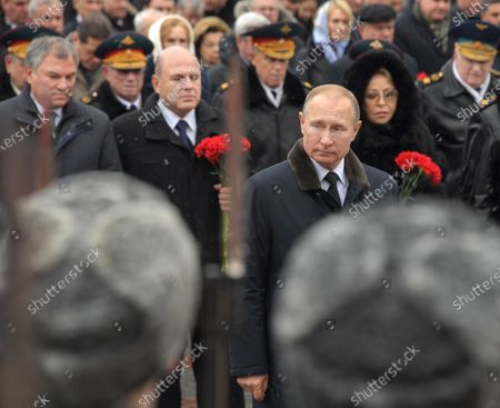 Stock Image of Wreath-laying ceremony at the Tomb of the Unknown Soldier in honor of Defender of the Fatherland Day. From left: Chairman of the State Duma of Russia Vyacheslav Volodin, Russian Prime Minister Mikhail Mishustin, President of Russia Vladimir Putin and Chairman of the Federation Council of Russia Valentina Matviyenko attend the ceremony