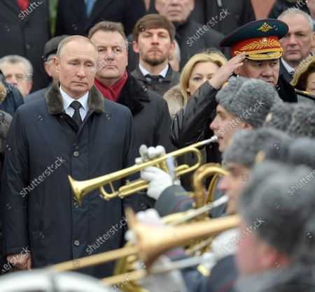Wreath-laying ceremony at the Tomb of the Unknown Soldier in honor of Defender of the Fatherland Day. President of Russia Vladimir Putin (left), Presidential Plenipotentiary to the Federation Council of Russia Artur Muravyov (second from left) and Minister of Defense of Russia Sergey Shoygu (right) attend the ceremony