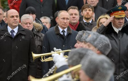 """Wreath-laying ceremony at the Tomb of the Unknown Soldier in honor of Defender of the Fatherland Day. From left: Russian Prime Minister Mikhail Mishustin, Head of """"A Just Russia"""" faction in the State Duma of Russia Sergey Mironov, President of Russia Vladimir Putin, Presidential Plenipotentiary to the Federation Council of Russia Artur Muravyov and Minister of Defense of Russia Sergey Shoygu attend the ceremony"""