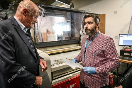Fab manager presents the laser cutter machine to the French Nouvelle-Aquitaine president Alain Rousset. The Cap sciences Fablab is totally dedicated to build protective visors during sanitary containment caused by the Covid-19 crisis. In Bordeaux, april 29, 2020.