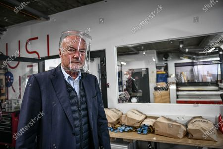 Stock Photo of French Nouvelle-Aquitaine president Alain Rousset visits Cap Sciences Fablab. The place is totally dedicated to build protective visors during sanitary containment caused by the Covid-19 crisis. In Bordeaux, april 29, 2020.