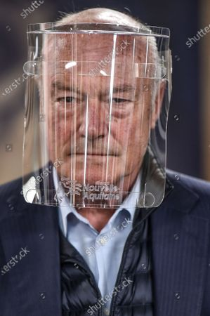 Stock Image of French Nouvelle-Aquitaine president Alain Rousset visits Cap Sciences Fablab. The place is totally dedicated to build protective visors during sanitary containment caused by the Covid-19 crisis. In Bordeaux, april 29, 2020.