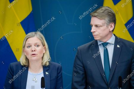 Swedish Finance Minister Magdalena Andersson (L) and Minister for Financial Markets and Housing Per Bolund speak during a news conference on approved extra means for the unemployment benefit scheme during the coronavirus / covid-19 crisis