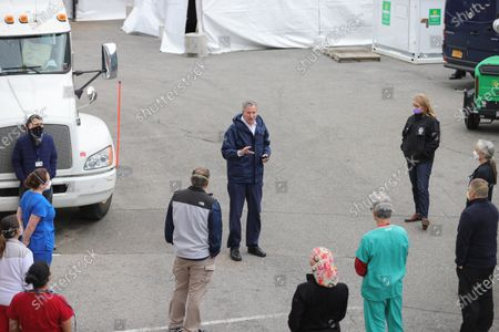 Mayor Bill de Blasio Greets Health Care Workers and Hold a Media Availability at the USTA Billie Jean King National Tennis Center. The Tennis Center was Transformed in to a New Temporary Hospital to Help on the Corona Virus Pandemic today in Flushing Meadows-Corona Park in Queens.