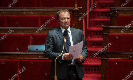 Stock Image of French Communist Party (PCF) Member of Parliament Stephane Peu listens during a debate on the extension of the state of health emergency at the National Assembly in Paris, France, 07 May 2020. France is on the 52nd day of a strict lockdown to stop the spread of the COVID-19 disease caused by the SARS-CoV-2 coronavirus.
