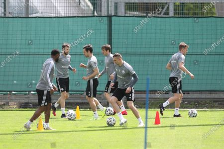 Legia's player Artur Jedrzejczyk (2R) attends a team's training session amid the ongoing coronavirus COVID-19 pandemic in Warsaw, Poland, 07 May 2020. Soccer players train in groups of 14 to prepare for the restart of the Polish Ekstraklasa league. In accordance with the guidelines of the football authorities, players of all Polish teams will be subject to medical re-examination. The first matches in Poland are scheduled to take place on 29 May 2020.
