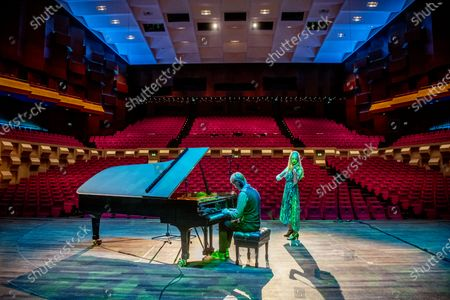 Musicians Merel Vercammen and Rembrandt Frerichs perform in an empty hall of De Doelen theater. One third of the Dutch theater and concert stages that have missed out on turnover since the corona virus is in danger of reaching the summer.