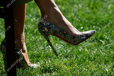 The Christian Louboutin shoes of first Lady Melania Trump during a White House National Day of Prayer Service in the Rose Garden of the White House, in Washington