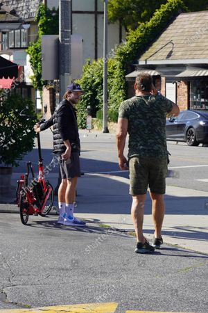 Patrick Schwarzenegger and Ralf Moeller out and about during quarantine