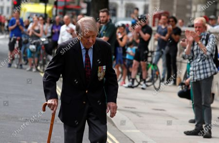 People applaud as WWII veteran Lou Myers, 92, as he walks past after two minutes of silence was observed in Whitehall in London, on the 75th anniversary of the end of World War II in Europe. The 75th anniversary of the end of World War II in Europe should be all about parades, remembrances, and one last great hurrah for veteran soldiers who are mostly in their nineties. Instead, it is a time of coronavirus lockdown and loneliness spent in search of memories both bitter and sweet