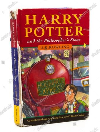 Stock Picture of Three Harry Potter first editions salvaged from skip could sell for thousands in bumper auction of Potter finds three Harry Potter first edition books rescued from a school skip 12 years ago are expected to sell for thousands of pounds at auction.  A hardback first edition of Harry Potter and the Philosopher's Stone - one of only 500 in the first ever print run - and two paperback versions of the same book have been unearthed by Hansons Auctioneers.  The hardback has an estimate of £8,000-£12,000 while the two paperbacks have a guide price of £2,000-£3,000 each. All are due to go under the hammer on May 21 in a bumper Harry Potter- themed Library Auction at Bishton Hall, Staffs.  Hansons' huge success with Potter books, which includes the discovery of two other 'rare as hens' teeth' Philosopher's Stone hardback first editions which together made £80,000 at auction, has led to many similar finds.  The May sale has 17 Potter auction lots. These include a total of five paperback first editions of Philosopher's Stone, each worth between £3,000-£5,000, plus books signed by author J K Rowling.  For example, lot 16 includes copies of Philosopher's Stone and Chamber of Secrets, both signed by Rowling, estimate £500-£800. In 1998, the seller went on a school trip to Waterstones in Nottingham where the author answered questions and signed books. But the star of the show is the first edition hardback of Philosopher's Stone as only 500 were published in 1997 when Harry Potter made his debut.