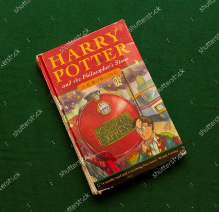 Three Harry Potter first editions salvaged from skip could sell for thousands in bumper auction of Potter finds three Harry Potter first edition books rescued from a school skip 12 years ago are expected to sell for thousands of pounds at auction.  A hardback first edition of Harry Potter and the Philosopher's Stone - one of only 500 in the first ever print run - and two paperback versions of the same book have been unearthed by Hansons Auctioneers.  The hardback has an estimate of £8,000-£12,000 while the two paperbacks have a guide price of £2,000-£3,000 each. All are due to go under the hammer on May 21 in a bumper Harry Potter- themed Library Auction at Bishton Hall, Staffs.  Hansons' huge success with Potter books, which includes the discovery of two other 'rare as hens' teeth' Philosopher's Stone hardback first editions which together made £80,000 at auction, has led to many similar finds.  The May sale has 17 Potter auction lots. These include a total of five paperback first editions of Philosopher's Stone, each worth between £3,000-£5,000, plus books signed by author J K Rowling.  For example, lot 16 includes copies of Philosopher's Stone and Chamber of Secrets, both signed by Rowling, estimate £500-£800. In 1998, the seller went on a school trip to Waterstones in Nottingham where the author answered questions and signed books. But the star of the show is the first edition hardback of Philosopher's Stone as only 500 were published in 1997 when Harry Potter made his debut.