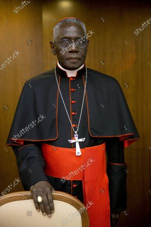 In this Oct. 14, 2015 photo, Cardinal Robert Sarah, prefect of the Congregation for Divine Worship and the Discipline of the Sacraments, arrives for the presentation of Cardinal Raymond Leo Burke's book Divine Love Made Flesh, in Rome. Cardinal Sarah, the highest ranking signatory of a petition signed by some conservative Catholics claiming the coronavirus is an overhyped pretext to deprive the faithful of Mass and impose a new world order, and which has run into a bit of a hitch, claims he never signed the petition. But archbishop Carlo Maria Vigano, who spearheaded the initiative, said that Sarah was fully on board with it, and has the recorded phone conversations to prove it