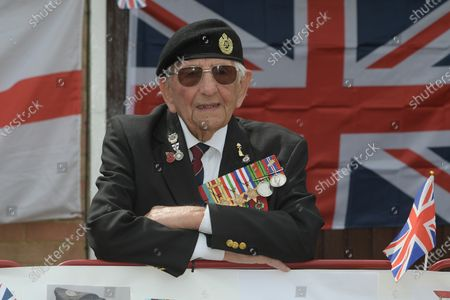 Stock Picture of D-Day veteran Don Sheppard who celebrated his 100th birthday this week commemorates the 75th anniversary of VE-Day at his Basildon home. The former Royal Engineers Sapper arrived on Juno beach on 6th June 1944 with the 155 Brigade Highland Division on a landing craft with his Bren gun equipped scout car. D-Day was not the first time Don had seen action as he had previously served in North Africa and Sicily. After breaking through enemy lines in August 1944 he continued through Belgium, Holland and eventually Germany where he was involved in the liberation of prisoners in the Bergen-Belsen concentration camp. Mr Sheppard confesses he was extremely fortunate to be only wounded once when taking cover from enemy bombing, in 2008 during a scan at Basildon Hospital it was found that a piece of shrapnel had sat in his lung undetected for 64 years from this incident.