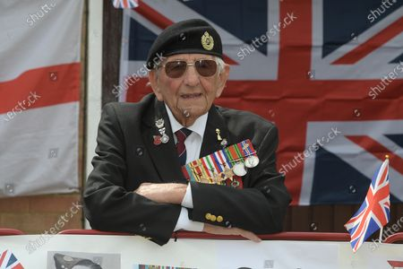 D-Day veteran Don Sheppard who celebrated his 100th birthday this week commemorates the 75th anniversary of VE-Day at his Basildon home. The former Royal Engineers Sapper arrived on Juno beach on 6th June 1944 with the 155 Brigade Highland Division on a landing craft with his Bren gun equipped scout car. D-Day was not the first time Don had seen action as he had previously served in North Africa and Sicily. After breaking through enemy lines in August 1944 he continued through Belgium, Holland and eventually Germany where he was involved in the liberation of prisoners in the Bergen-Belsen concentration camp. Mr Sheppard confesses he was extremely fortunate to be only wounded once when taking cover from enemy bombing, in 2008 during a scan at Basildon Hospital it was found that a piece of shrapnel had sat in his lung undetected for 64 years from this incident.