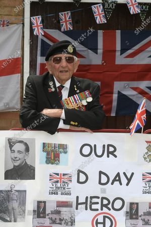 Stock Image of D-Day veteran Don Sheppard who celebrated his 100th birthday this week commemorates the 75th anniversary of VE-Day at his Basildon home. The former Royal Engineers Sapper arrived on Juno beach on 6th June 1944 with the 155 Brigade Highland Division on a landing craft with his Bren gun equipped scout car. D-Day was not the first time Don had seen action as he had previously served in North Africa and Sicily. After breaking through enemy lines in August 1944 he continued through Belgium, Holland and eventually Germany where he was involved in the liberation of prisoners in the Bergen-Belsen concentration camp. Mr Sheppard confesses he was extremely fortunate to be only wounded once when taking cover from enemy bombing, in 2008 during a scan at Basildon Hospital it was found that a piece of shrapnel had sat in his lung undetected for 64 years from this incident.
