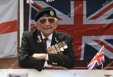 Stock Photo of D-Day veteran Don Sheppard who celebrated his 100th birthday this week commemorates the 75th anniversary of VE-Day at his Basildon home. The former Royal Engineers Sapper arrived on Juno beach on 6th June 1944 with the 155 Brigade Highland Division on a landing craft with his Bren gun equipped scout car. D-Day was not the first time Don had seen action as he had previously served in North Africa and Sicily. After breaking through enemy lines in August 1944 he continued through Belgium, Holland and eventually Germany where he was involved in the liberation of prisoners in the Bergen-Belsen concentration camp. Mr Sheppard confesses he was extremely fortunate to be only wounded once when taking cover from enemy bombing, in 2008 during a scan at Basildon Hospital it was found that a piece of shrapnel had sat in his lung undetected for 64 years from this incident.