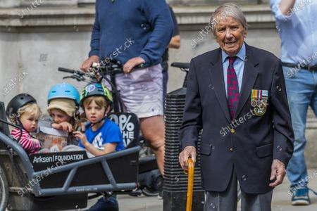 Lou Myers, 93, a veteran of the Royal Artillery comes, from his home in Covent Garden, to pay his respects - he is dissappointed that not many of his comrades came and is frustratedd by the lockdown restrictions ofr older people. He left his wife at home sunbathing on the roof! People gather near the Cenotaph for the 2 minutes silence. VE Day is remembered on its 75th anniversary.