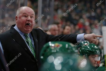 """Minnesota Wild's head coach Bruce Boudreau shouts after a penalty call in the second period of an NHL hockey game against the Vancouver Canucks in St. Paul, Minn. Boudreau played for the team the movie """"Slap Shot"""" was based off of and has a non-speaking role. His recollections include the 10 hours a day in uniform waiting to shoot a scene, how brutally real some of the big hits were and the night he got to spend with Paul Newman, director George Roy Hill and Dave Hanson in the film room. """"Paul turns around to me at the one point and he said: 'This is gonna be a great movie. Trust me,'"""" Boudreau recalled. """" And I'll never forget it. ... He was right"""