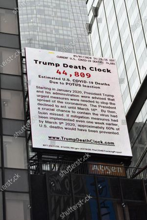 The Trump Death Clock, a 56-foot billboard that calculates the portion of U.S. COVID-19 deaths caused by President Trump's delayed response to the pandemic, is unveiled in Times Square by filmmaker Eugene Jarecki