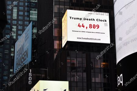 Stock Picture of The Trump Death Clock, a 56-foot billboard that calculates the portion of U.S. COVID-19 deaths caused by President TrumpÕs delayed response to the pandemic, is unveiled in Times Square by filmmaker Eugene Jarecki