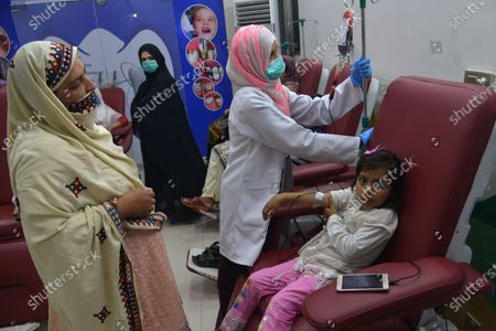 Pakistani children affected by Thalassemia being treated by blood transfusion at Sundas Foundation Center as blood for Thalassaemia patients is too short due to pandemic COVID-19 and Ramzan ul Mubarak, while world observe International Thalassaemia Day in Lahore. Thalassemia is a genetic disease of the blood where patients cannot produce enough hemoglobin, the substance in red blood cells that transport oxygen from the lungs.