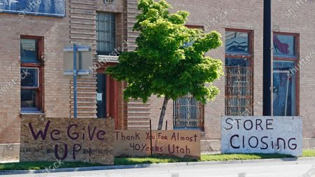 Store closing signs are shown in front of Euro Treasures Antique store, in Salt Lake City. Owner Scott Evans is closing his art and antique store after 40 years. This year started out well for his business, then COVID-19 hit, along with shelter-in-place orders. With a drastic drop in customers, Evans says it was no longer cost effective to stay open. The U.S. unemployment rate hit 14.7% in April, the highest rate since the Great Depression, as 20.5 million jobs vanished in the worst monthly loss on record