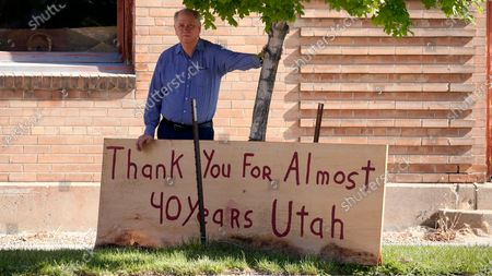 """Stock Picture of Euro Treasures Antiques owner Scott Evans poses next to a """"thank You"""" sign, in Salt Lake City. Evans is closing his art and antique store after 40 years. With a drastic drop in customers due to COVID-19 concerns and shelter-in-place orders, Evans says it was no longer cost effective to stay open"""