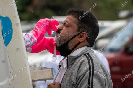 Doctor takes a nasal swab to be tested for the coronavirus in Dharmsala, India, . India relaxed some coronavirus lockdown restrictions on Monday even as the pace of infection picked up and reopenings drew crowds of people