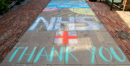 A Thank you NHS chalk mural on the pavement outside the entrance to an Eton College boarding house. Key workers are staying in some of the boarding houses at the college so that they can carry on working whilst their families stay safe at home