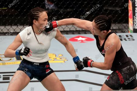Stock Picture of Carla Esparza, right, lands a punch on Michelle Waterson during a UFC 249 mixed martial arts bout, in Jacksonville, Fla
