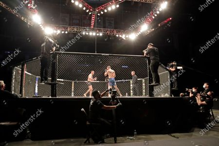Anthony Pettis, center left, and Donald Cerrone fight during a UFC 249 mixed martial arts bout, in Jacksonville, Fla