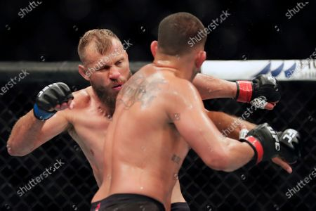 Donald Cerrone, left, fights Anthony Pettis during a UFC 249 mixed martial arts bout, in Jacksonville, Fla