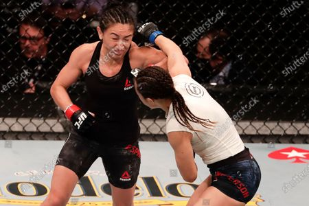 Carla Esparza, left, fights Michelle Waterson during a UFC 249 mixed martial arts bout, in Jacksonville, Fla