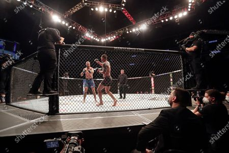 Donald Cerrone, center left, and Anthony Pettis fight during a UFC 249 mixed martial arts bout, in Jacksonville, Fla