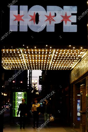 "The marquee of the James M. Nederlander Theatre reads ""HOPE"" in downtown Chicago, during the COVID-19 pandemic"