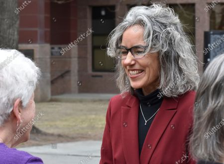 Former state Rep. Kathleen Williams, right, smiles to a supporter after announcing her candidacy for Montana's U.S. House seat at a rally in Billings, Mont. Williams, a Democrat, lost a bid for the seat in 2018 and is making another run this year after U.S. Rep. Greg Gianforte did not seek re-election. Women candidates are positioned to make significant gains in Montana's election this year with the highest number seeking statewide political office in at least two decades, including races for governor, U.S. House and other high-profile posts