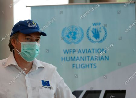 EU Ambassador to Myanmar Kristian Schmidt wearing a face mask looks on at Yangon International Airport in Yangon, Myanmar, 10 May 2020. The first humanitarian flight with 10,000 COVID-19 coronavirus disease test kits has arrived in Myanmar as part of the United Nations Children's Fund (UNICEF) ongoing support, along with the Myanmar Ministry of Health and Sports (MoHS), to scale up testing capacity in the fight against the coronavirus pandemic. Countries around the world are taking increased measures to stem the widespread of the SARS-CoV-2 coronavirus, which causes the COVID-19 disease.