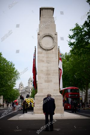Stock Picture of Royal Artillery veteran Lou Myers, 92, at the Cenotaph on VE Day during the Coronavirus lockdown