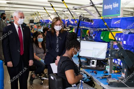 Stock Photo of Vice President Mike Pence tours the General Motors/Ventec ventilator production facility with GM CEO and Chairman Mary Barra in Kokomo, Ind