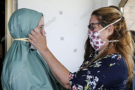 Italian cooperator, Silvia Romano (L), wearing a green tunic, is hugged by her mother Francesca Fumagalli upon her arrival at the Ciampino airport, Rome, Italy, 10 May 2020. Silvia Romano, who was kidnapped by gunmen from an orphanage in Kenya 18 months ago, has been freed, Italian Prime Minister Giuseppe Conte announced.
