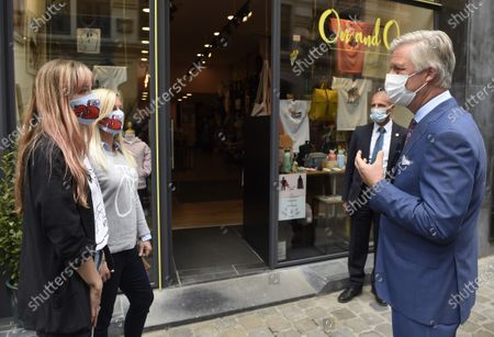 King Philippe - Filip of Belgium (wearing a mask) pictured in front of the On and On shop during a royal visit to several shops on and near the Grasmarkt - Marche aux Herbes, in the city center of Brussels, Sunday 10 May 2020. These shops were severely touched by the lockdown measures taken to prevent the spreading of the Corona Virus. As from Monday 11 May, Belgium enters a new phase in the Exit Strategy. All shops can reopen, taking into account several safety measures, for example regarding social distancing.