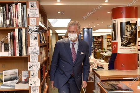 King Philippe - Filip of Belgium (wearing a mask) pictured in front of Tropismes library during a royal visit to several shops on and near the Grasmarkt - Marche aux Herbes, in the city center of Brussels, Sunday 10 May 2020. These shops were severely touched by the lockdown measures taken to prevent the spreading of the Corona Virus. As from Monday 11 May, Belgium enters a new phase in the Exit Strategy. All shops can reopen, taking into account several safety measures, for example regarding social distancing.