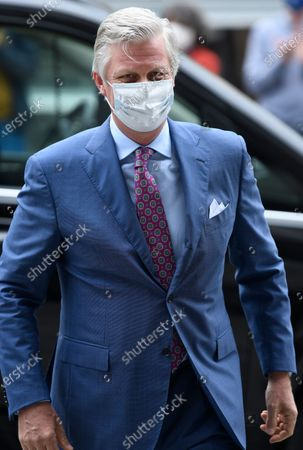King Philippe or Filip of Belgium wears a mask as he chats with people in the street during a visit to several shops in Brussels' city center, Belgium, 10 May 2020. From 11 May, all shops will be open in Belgium. In order to contain the spread of coronavirus, Belgium implemented confinement guidelines for the public which is scheduled to be in place until 11 May 2020.