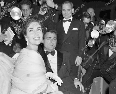 Stock Image of Film star Elizabeth Taylor and her husband, producer Mike Todd are surrounded by photographers at the Cannes Film Festival in Cannes. It is one of the indelible moments the Cannes Film Festival has created throughout its history, and more were likely to be made when it opened on . This year's festival has been postponed due to the coronavirus pandemic